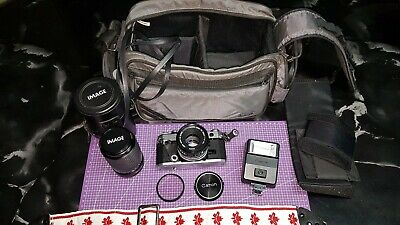 Canon AE-1 35mm SLR Film Camera with FD 50mm 1:1.8 lens, 70mm-210mm lens, extras