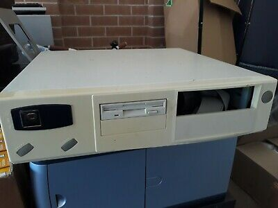 Vintage Osborne small form AT case with power supply, floppy drive and cables
