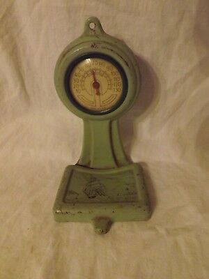 Vintage pressed tin thermometer in shape of a scale with litho of lighthouse
