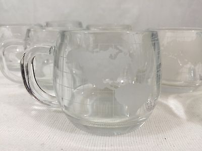 Nestle Company, Clear Glass cup/ mug etched world map on each, set of (7),