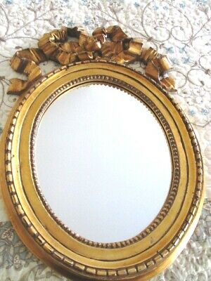Vintage Hollywood Regency Ornate Gold Painted Carved Bow Wood Tole Wall Mirror