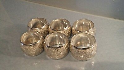 A set of six solid silver napkin rings probably  Indian silver eastern style