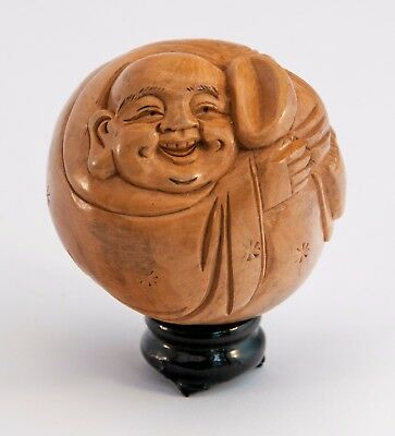 Small Chinese Ball Carving of a Cheeky Wiseman in Light Colour Wood