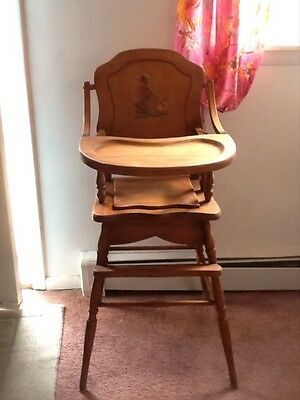 E. L. Thompson Vintage High Chair 1990 - 1950. America, Medium Wood tone.
