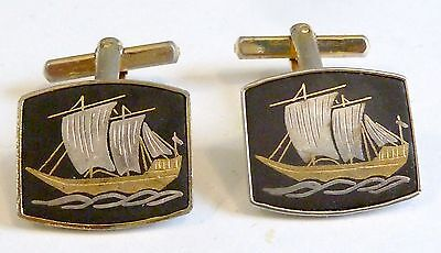 A Pair Of Gold Plated Shakudo Cufflinks With Inlaid Gold & Silver Sailing Ship