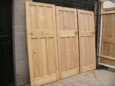 Reclaimed 1930s 3 over 3 panel stripped pine doors.