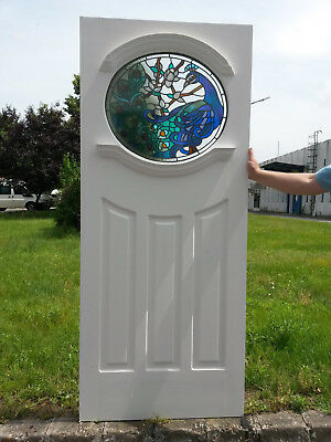 1930's Oval front door with Peacock stained glass design .