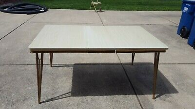 Mid century kitchen table with light grain formica top and metal skirt NEW PRICE