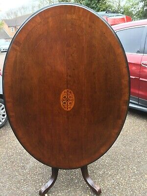 Antique victorian inlaid tilt top dining table with geometric centre panel