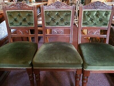 6 Mahogany or walnut chairs with carved decorative design - re-upholstered