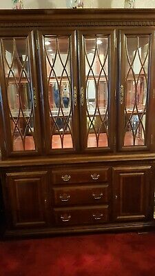 vintage dark wood cabinet with glass