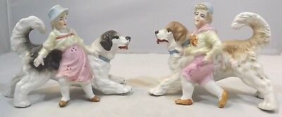Antique Pair of German China Opposing Dog Figurines, Featuring a Boy & a Girl