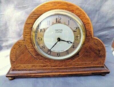 VINTAGE SMITHS 8 DAY MANTLE / SHELF CLOCK. OAK CASE WITH FRONT INLAYS.1950's