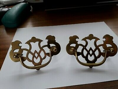 Pair of decorative  vintage brass drawer handles. Reclaimed used condition.