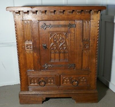 French Arts and Crafts Gothic Carved Golden Oak Cupboard