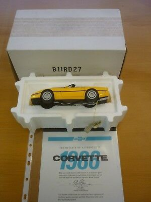 A Franklin mint of a scale model of a 1986 Chevrolet corvette, boxed, paperwork