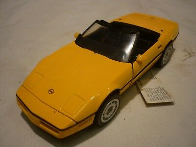 A Franklin mint of a scale model of a 1986 Chevrolet corvette, no box