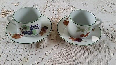 Two Royal Worcester Evesham Vale Cups And Saucers