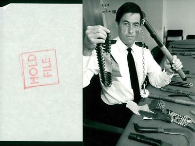 Weapons: Brian Butcher shows some offensive weapons - Vintage photo