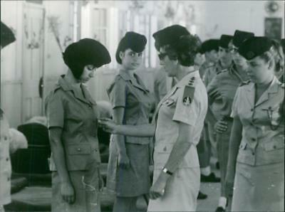 Vintage photo Stella Levy inspecting the uniforms of her soldiers. Photo taken o