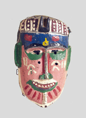 A colourful painted Bozo mask