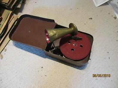 A  small wind up toy  gramophone phonograph with horn