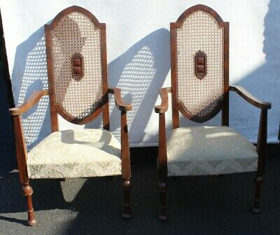 1920s Pair of Gothic style Mahogany Armchairs with Cane Backs.