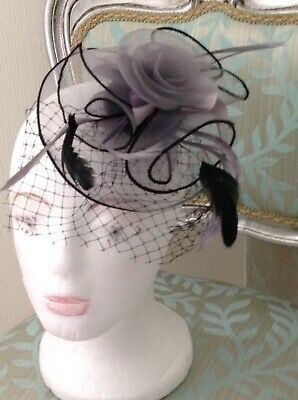 BRAND NEW black & grey feather Fascinator. Hair Accessory Prom, Wedding, Races