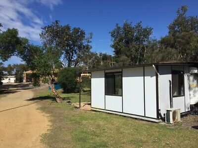 Caravan (12-14ft?) and solid annex onsite at Woodside Beach Caravan Park.
