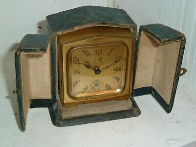Art Deco French brass cased Brevet alarm clock GWO with carry case