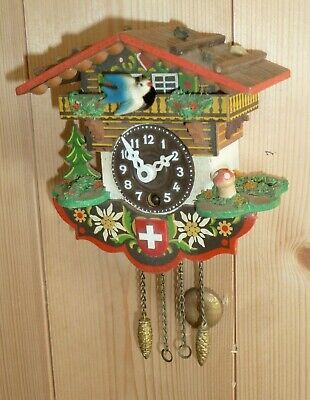 Vintage miniature Black Forest wall clock with moving bird
