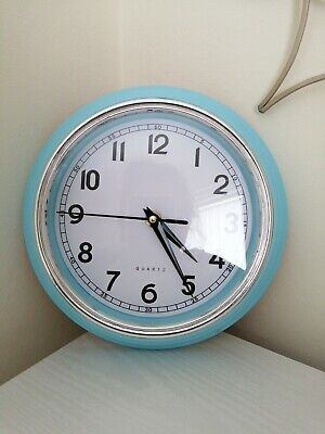 wall clock blue in colour. Perfect working order. Battery included