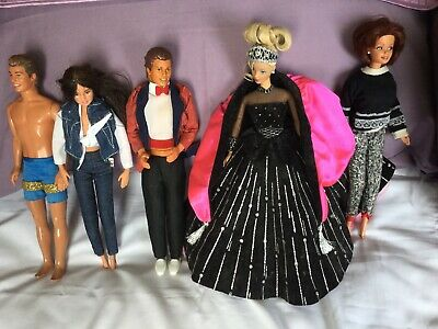 Five Vintage Dressed Barbie Dolls Two Boy Dolls In Good Used Condition