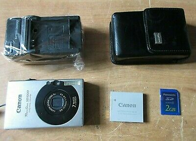 Canon PowerShot ELPH SD1000 7.1MP Digital Camera w Charger + Case +2GB Mem Card