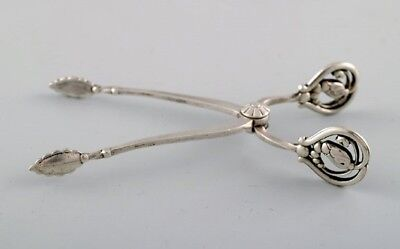 Georg Jensen sugar tang in sterling silver, 'Blossom'. Produced 1925 - 1932.