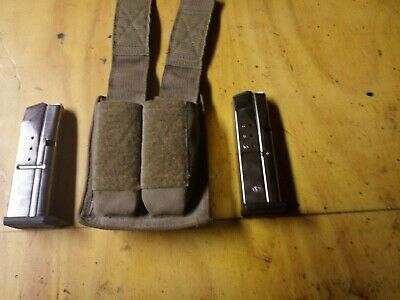 2 Smith & Wesson 9mm magazines with molle case (used)