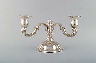 Two-armed neo rococo candlestick with curved arms in silver (830). 1930 / 40's.