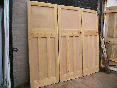 Reclaimed 1920s or 1930s 1 over 3 panel stripped pine doors.