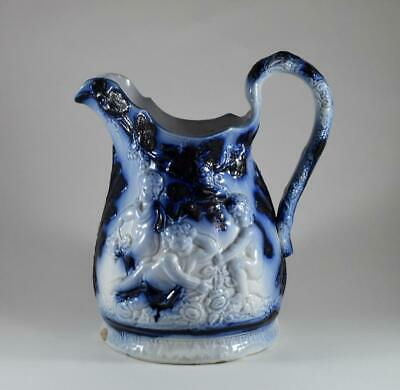 Antique Relief Moulded Flow Blue Porcelain Water Jug