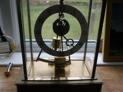 A Vintage German Kundo Electromagnetic Clock Under Glass cover