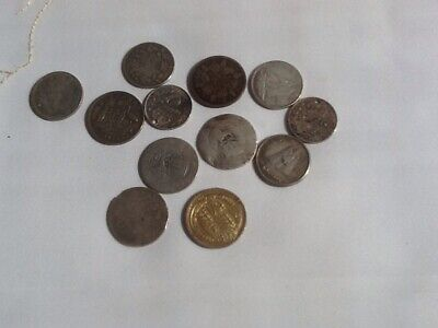 Twelve Silver Coins Of The World.