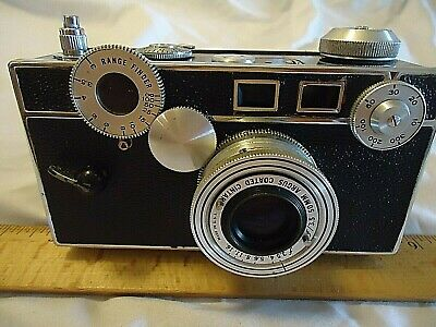 ARGUS CINTAR CAMERA  50mm f 3.5 LENS WITH  LEATHER CASE SHUTTER FIRES