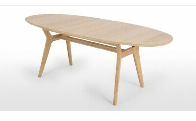 Made.com Jenson oval extending dining table in oak. Delivery available