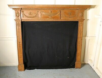 A Large 19th Century Adams Style Stripped Pine Fireplace.