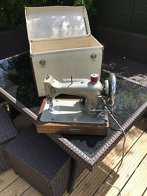 Vintage electric  EMPRESS Universal Heavy Duty  Portable Sewing Machine