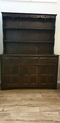 large solid dark oak carved 3 door/drawers dresser
