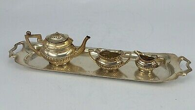 A harlequin set of Silver miniature tea set and silver tray, dolls house piece