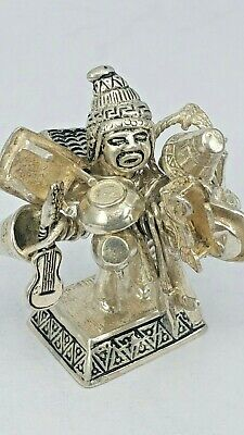 Solid silver miniature figure of a Peruvian market peddler  with 15 silver items