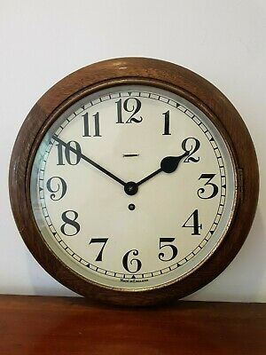 An Attractive Vintage Smiths Oak Round Wall Clock Railway/School Style with Key