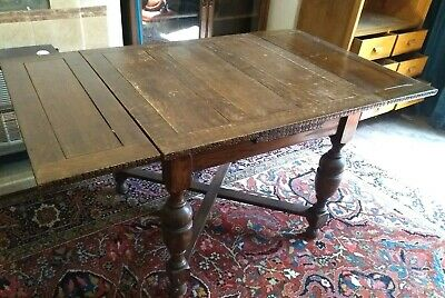 1930s vintage solid oak wooden extendable dining table carved edges. Maple & Co.